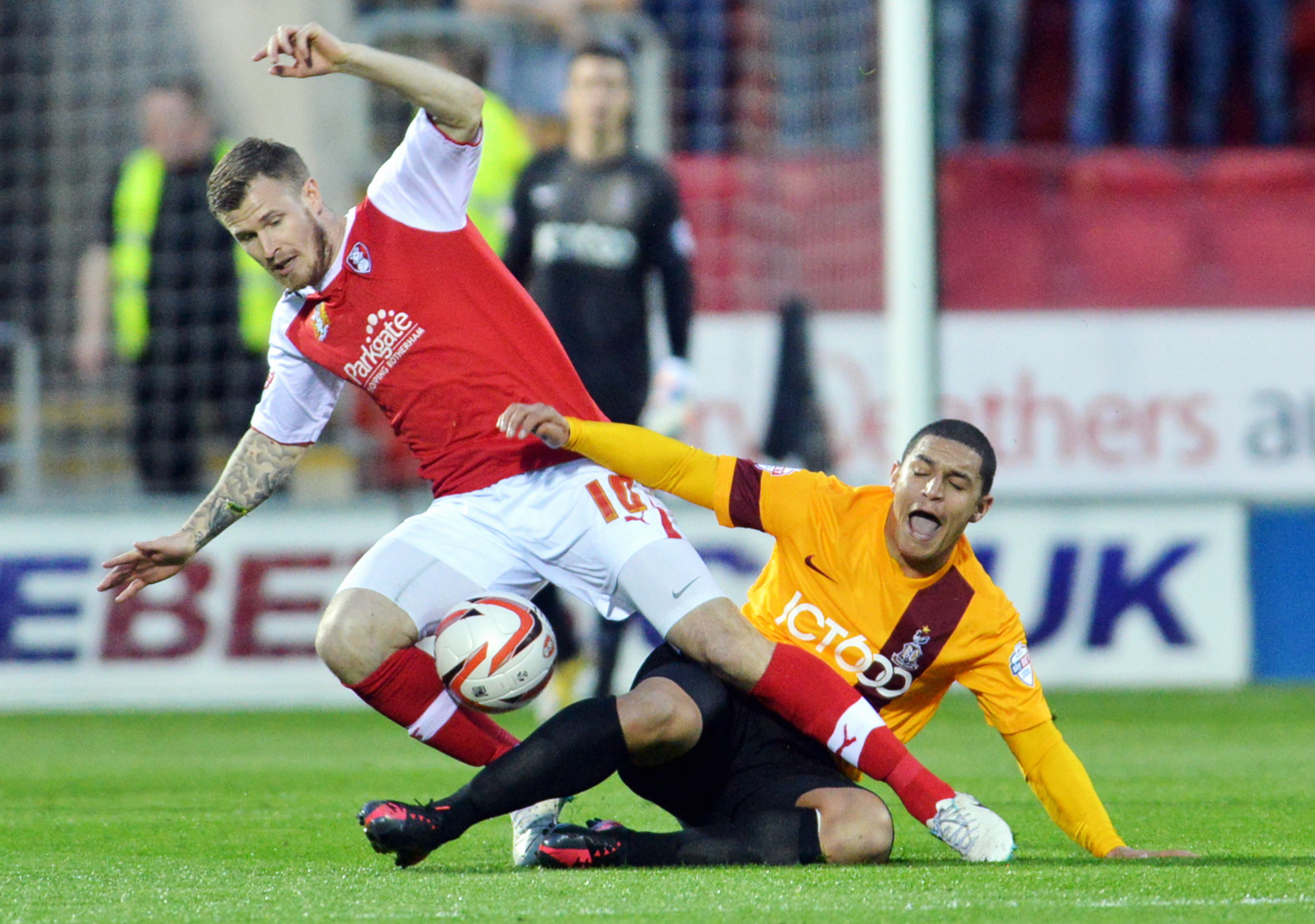 Nathan Doyle reacts to a strong tackle by Michael O'Connor of Rotherham