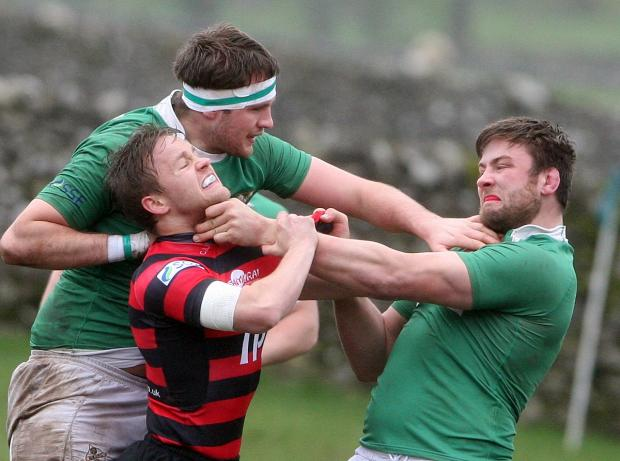 Bradford Telegraph and Argus: Tempers boil over during Wharfedale's home match against Blackheath as Rob Baldwin grabs Jack Walsh by the nthroat