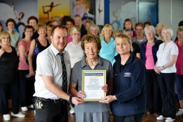 90-year-old Mary Sugden receives a B-active award from Marc Taylor and Christine Robinson