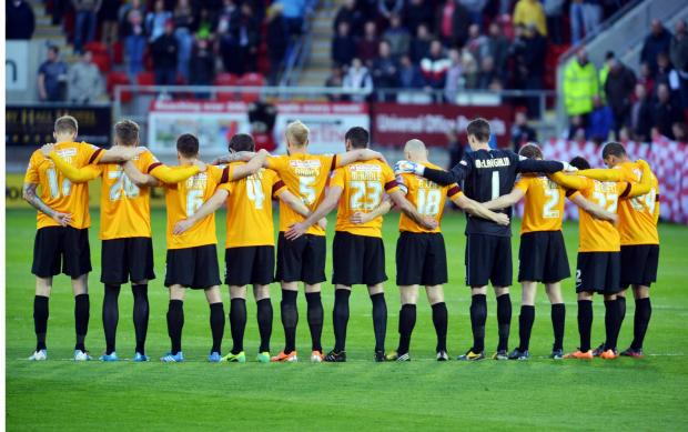 City players observe a minute's silence ahead of Friday's match at Rotherham