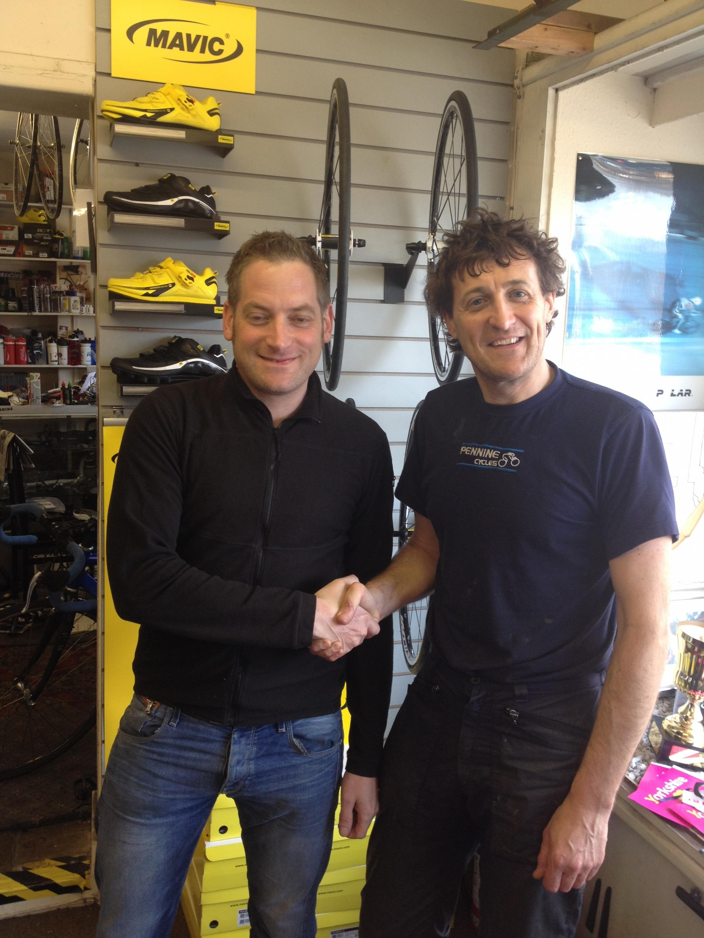 Matt Carter, from Mavic and Paul Corcoran, managing director of Pennine Cycles