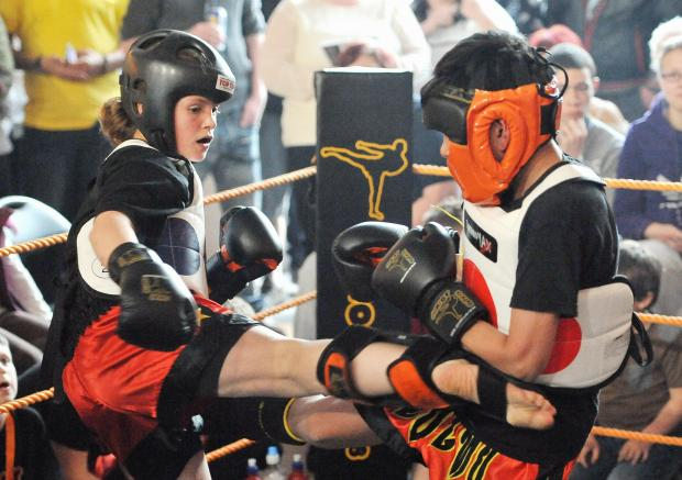Shannon Lawler and Reece Hussain in the ring at a kickboxing event at Junior Jam at Wyke