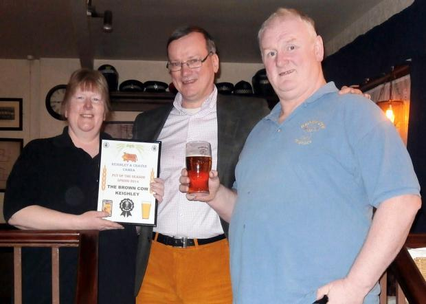 Pictured are Tony Davies (centre), of CAMRA, with Carol Taylor-Smith and Barry Smith of the Brown Cow