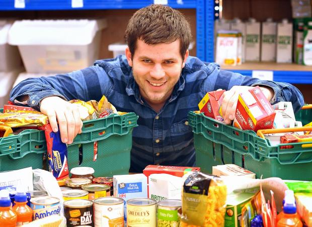 IN DEMAND: Ben Haldane, manager of the Bradford Foodbank with some of the food at the centre