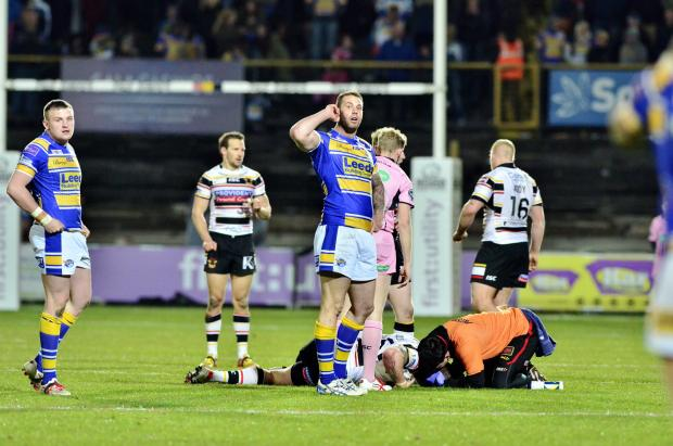 Adam Sidlow receives treatment during the defeat to Leeds as the Bulls' injury concerns mount