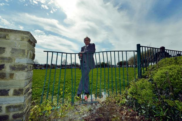 Councillor Ghazanfer Khaliq is pictured with a damaged fence on Thornbury roundabout