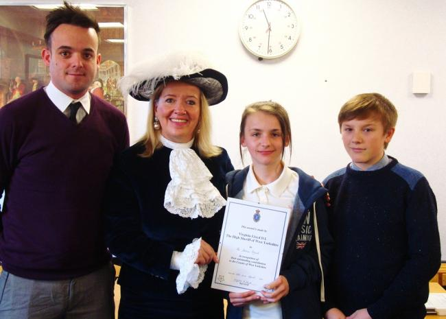 The High Sheriff is pictured with Rich Jones and two children from the Joshua Project