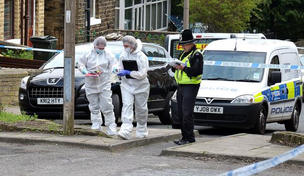 Police forensics officers at the scene of the murder in Girlington
