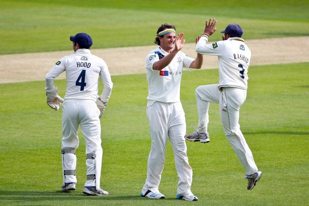 Adil Rashid celebrates with bowler Jack Brooks after the dismissal of David Willey