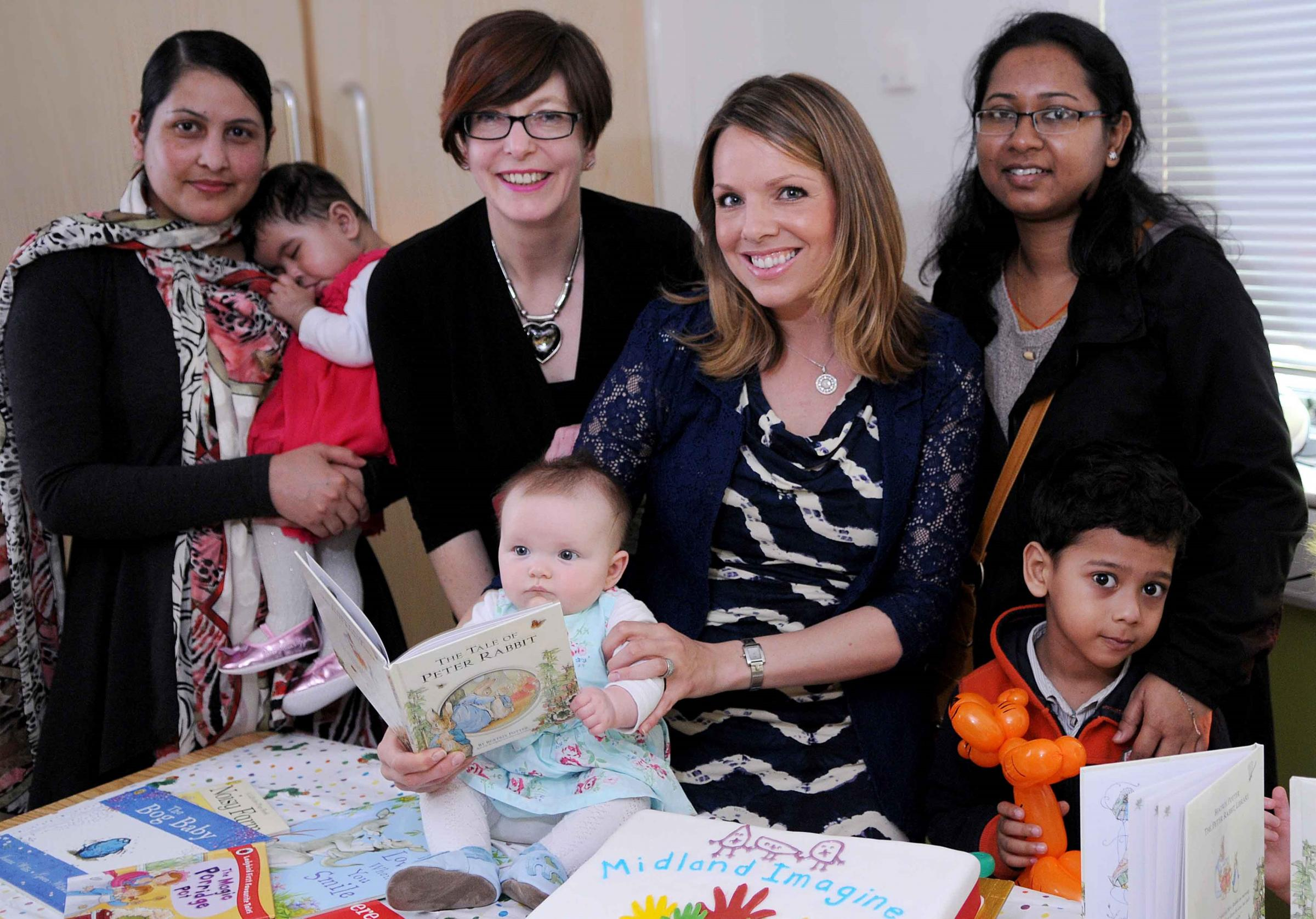 Scheme founder Jan Winter (second adult from left) is joined by mums including TV news presenter Nicola Rees (second adult from right) at the launch of the Midland Road books projec