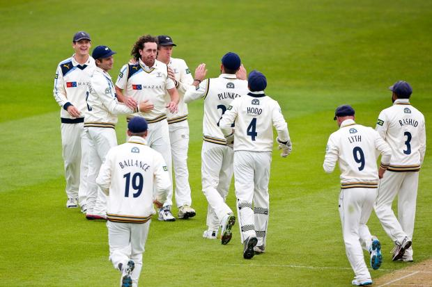 Ryan Sidebottom is congratulated on getting Stephen Peters caught behind