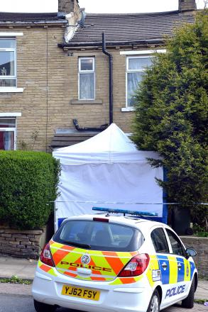 The police forensic tent at the scene