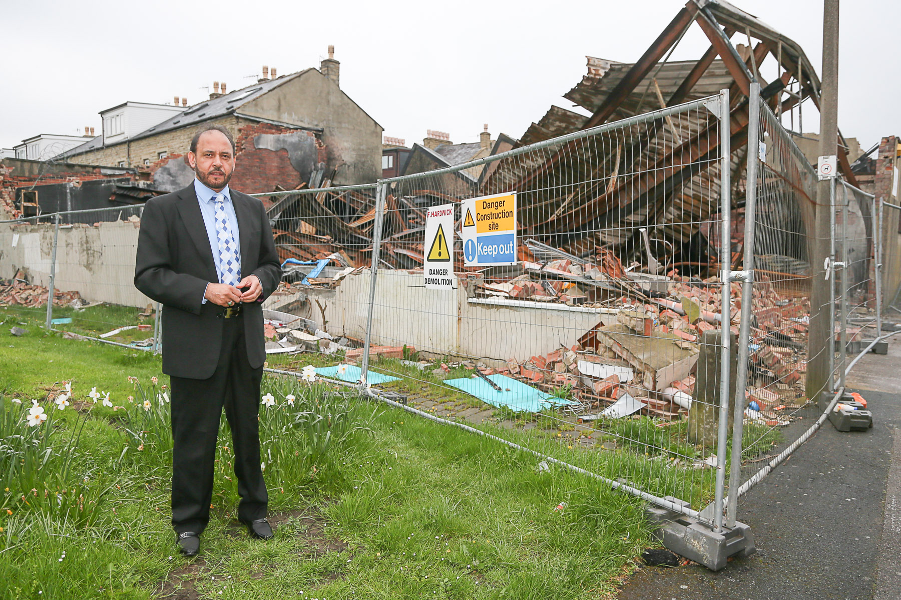 Councillor Abid Hussain at the fire damaged building on Lawkholme Lane