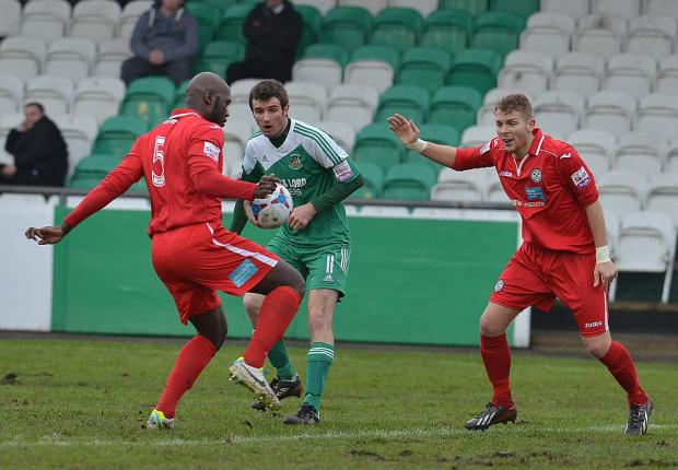 Paul Walker, centre, has made 98 successive appearances since signing for Bradford Park Avenue