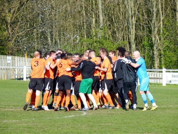 CHAMPIONS! The celebrations begin after Brighouse clinched the title against Retford