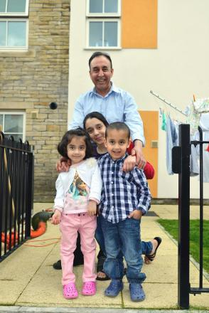 The Wouded Kahleghi family in their Chain Street home, dad Abdul, Shabnam, 12, twins Mina and Milaad, five