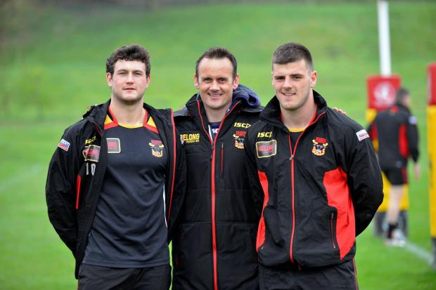 Francis Cummins shows off his new recruits Jay Pitts, left, and Joe Arundel following their season-long loan signings from Hull FC