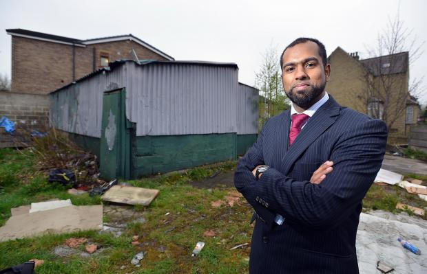 SITE: Rashid Moghul on the site in Parkside Road where it is proposed they build a community and education centre