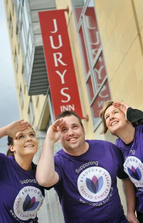 Jenny Watkinson and Victoria Collins from the University of Bradford join Jury's Inn Operations Manager, Mark Bussey, ahead of the charity abseil down the building