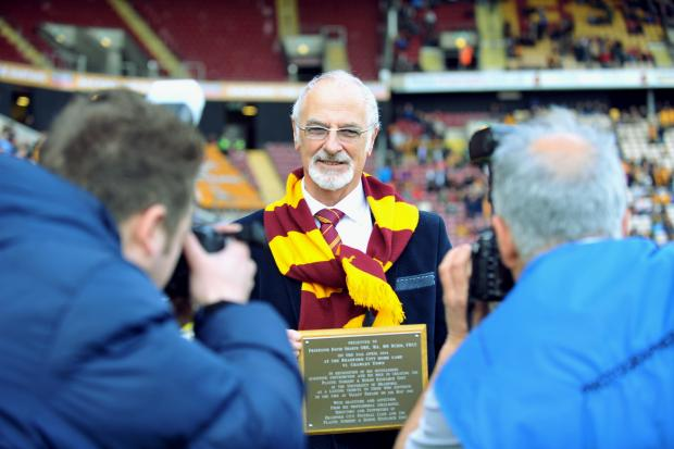 THANKS: Professor David Sharpe with a plaque of thanks which was presented to him during half-time of Saturday's match at Valley Parade