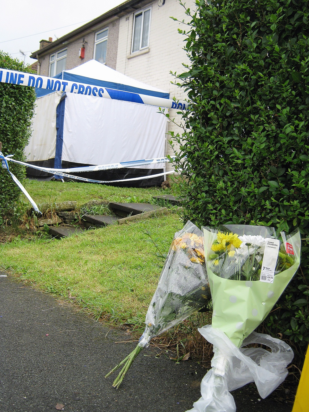 The police tent outside Clement Desmier's house in 2012 after the father of six was found dead with massive injuries