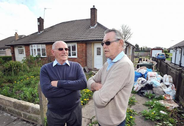 Kings Road residents George Young and Alan Pargeter in front of the unoccupied bungalow