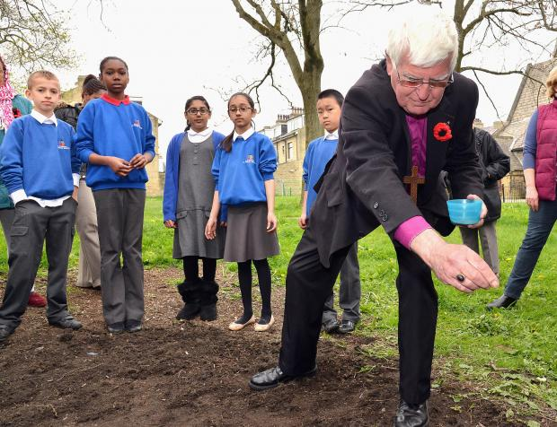 Bishop Tom Butler planting the seeds
