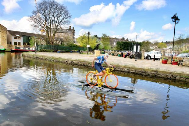 Skipton Waterways Festival organiser Ian Clark of Pennine Cruises on his 'Tour de Cut' bike