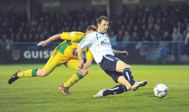 Adam Boyes shoots Guiseley in front as they won their play-off first leg 2-0