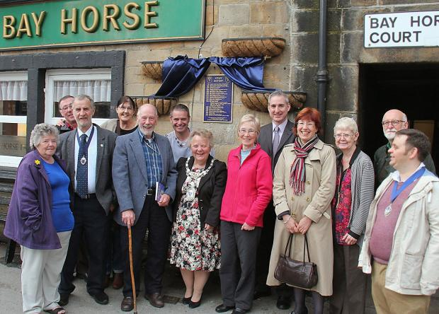 John Morgan (front row, third from left) with Otley Town Mayor Councillor Pam Gill, MP Greg Mulholland, guests and others who contributed to the new history plaque and book. Picture by John Chippendale