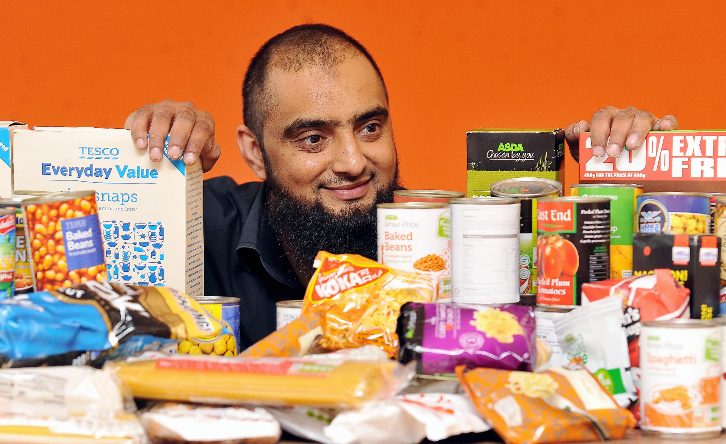 HOPE: Founder and Board Member of Intouch Foundation food bank, Osman Gondal, with some of the donated food