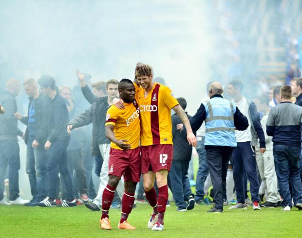 Bradford Telegraph and Argus: City goalscorers Aaron Mclean and Jon Stead hug at the end of the game