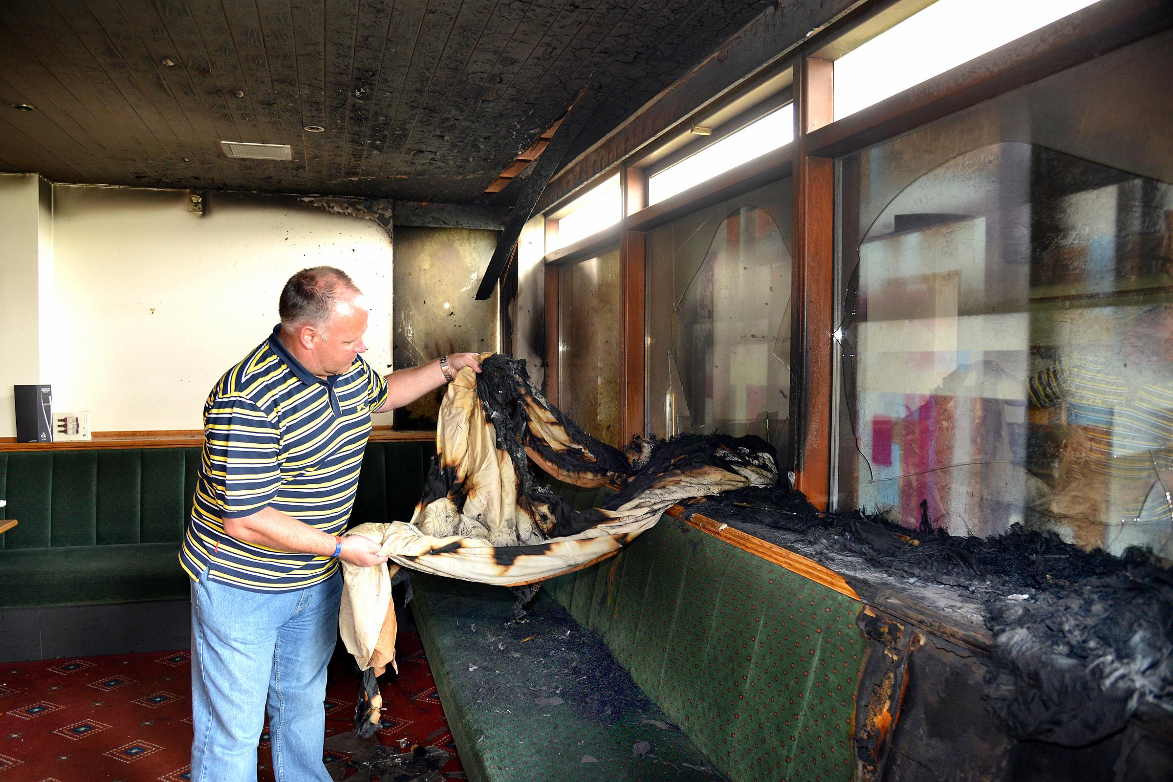 Chris Frost assisstant treasurer at Undercliffe Cricket Club surveys the fire damage caused by vandals at the club
