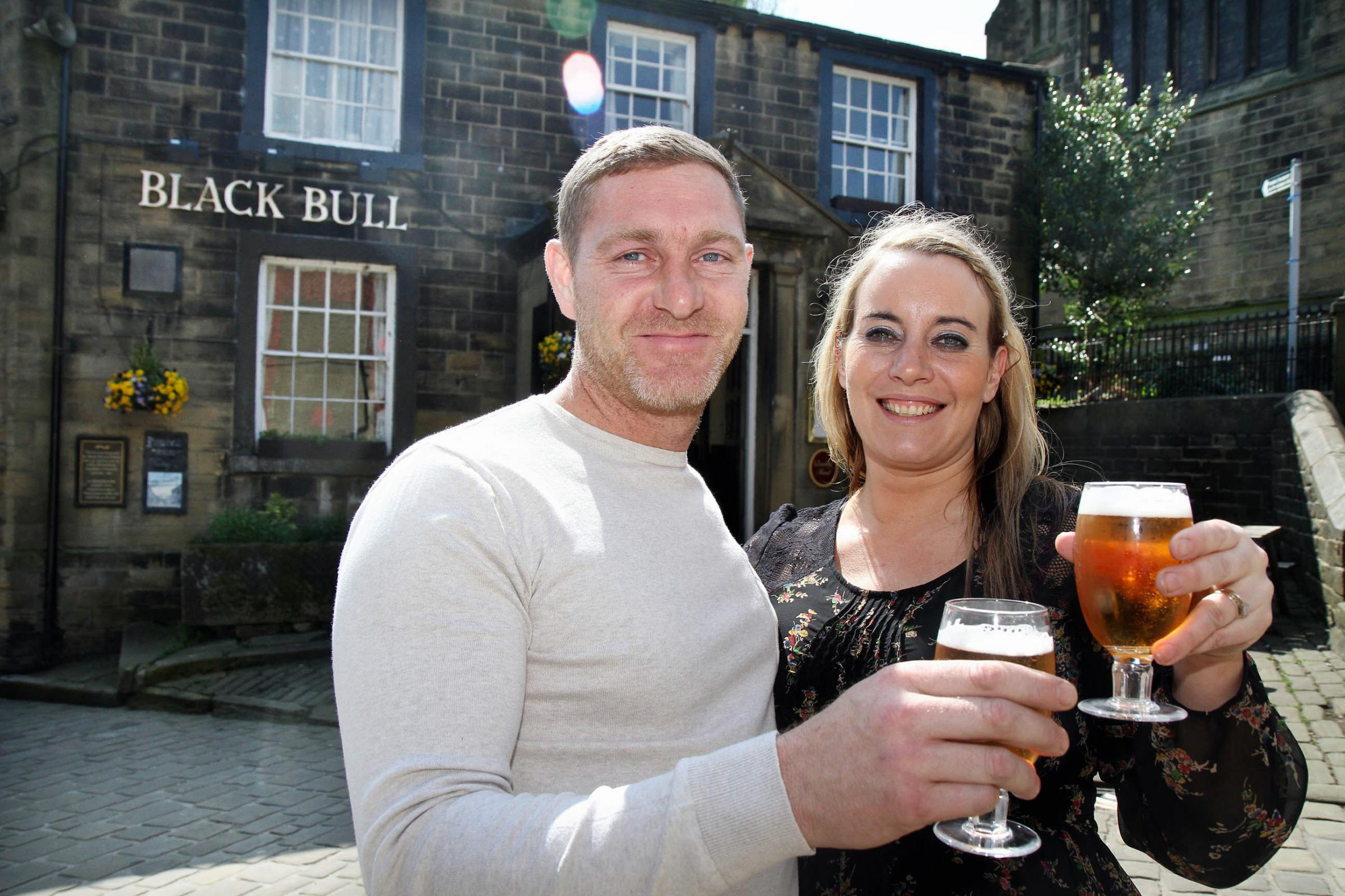 CHEERS: Leanne Forbes and her partner Michael Dewsnap outside the Black Bull pub in Haworth