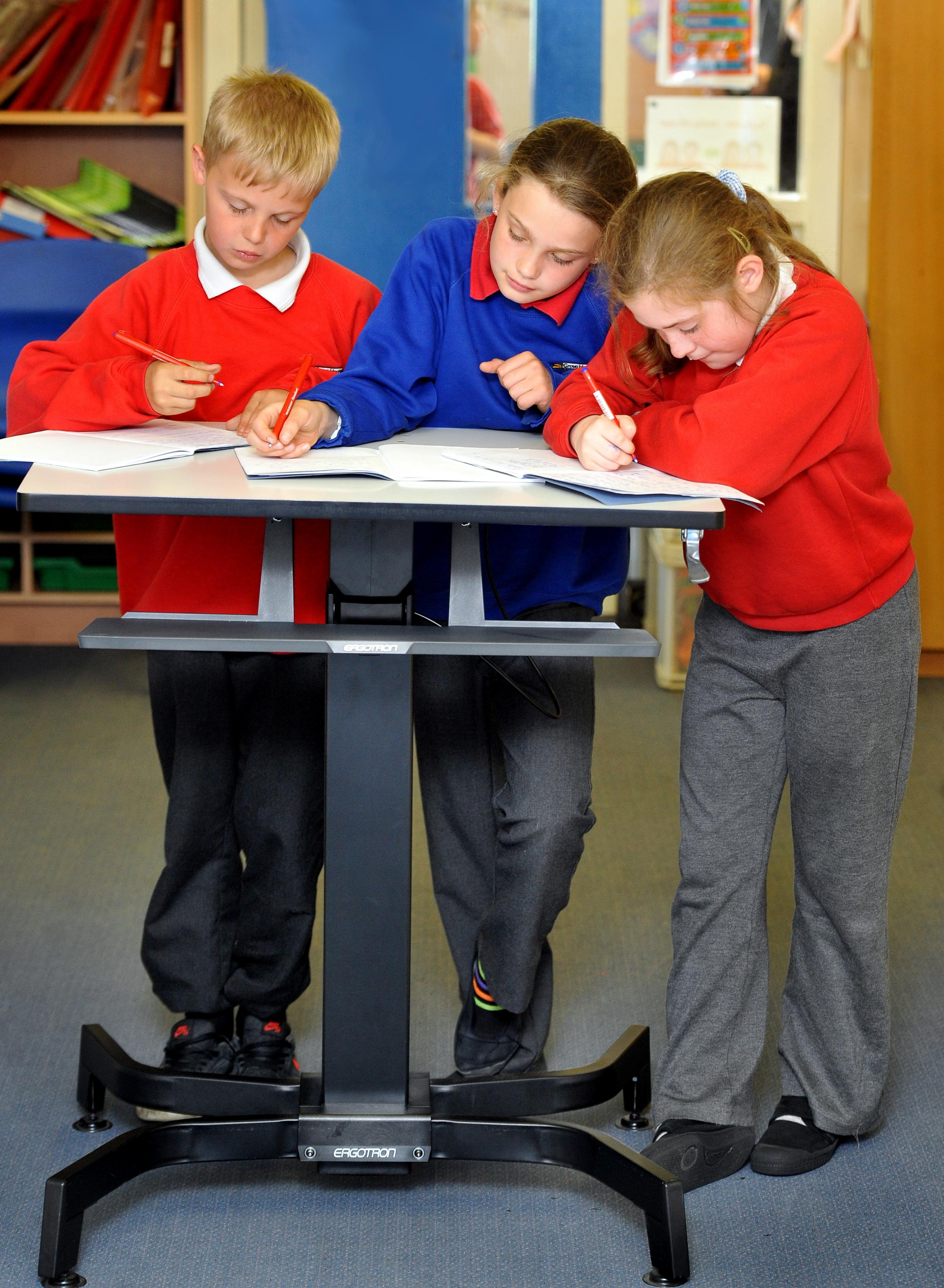 Pupils learn on the innovative sit-stand desks