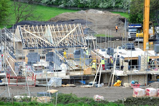 Bradford Telegraph and Argus: New homes being erected at Poplar Farm in Bradford