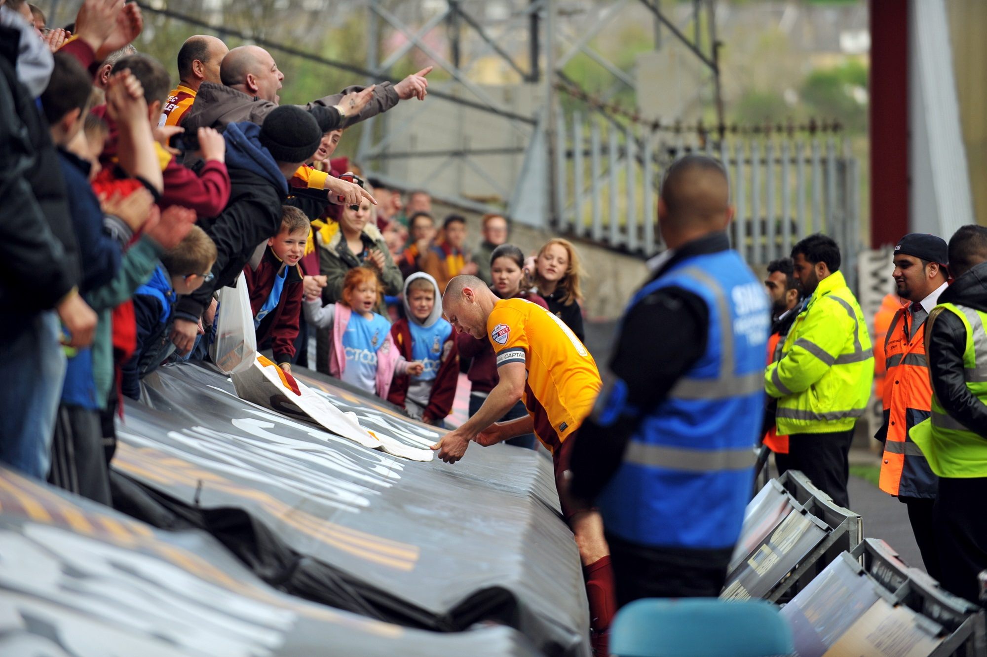 Gary Jones signs autographs for fans at City's last home game of the season against Crawley