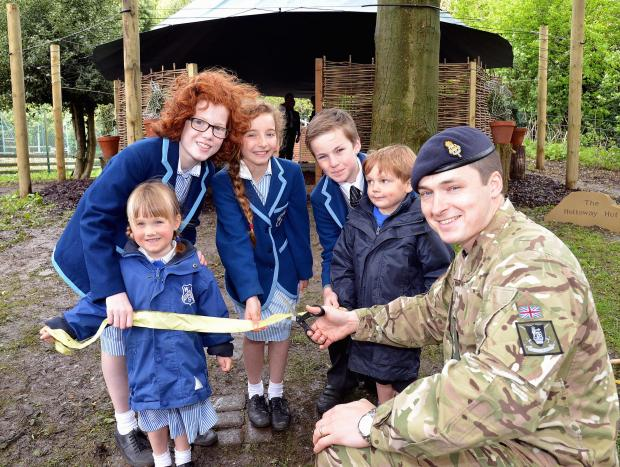 Captain Shaun Brown officially opens the Holloway Hut watched by pupils at Westville House School