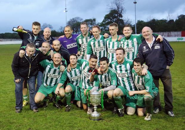 West Bowling players celebrate their cup final victory - Picture: Alex Daniel
