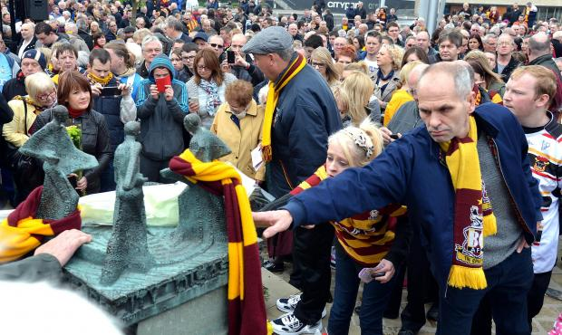Bradford Telegraph and Argus: City supporters pay their respects at the Memorial Sculpture