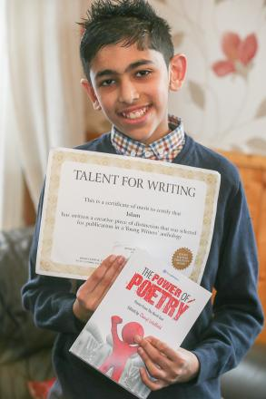Islam Hussain with his poetry award