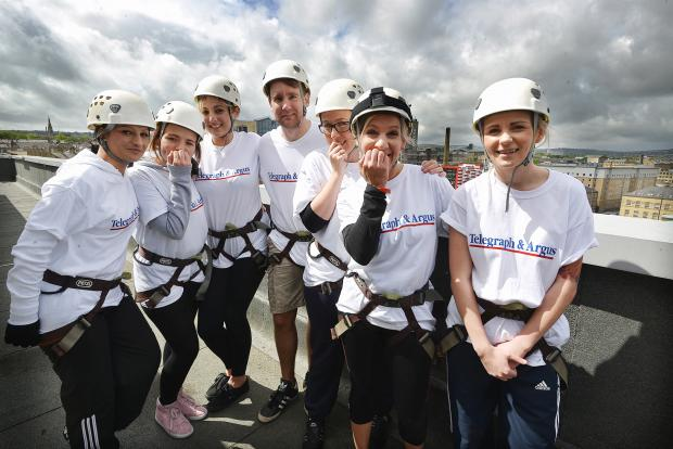Bradford Telegraph and Argus: The Telegraph and Argus team look nervous before their abseil down the Jurys Inn building