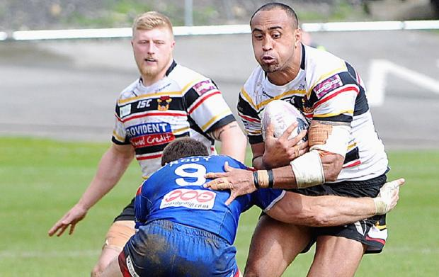 Antonio Kaufusi runs into trouble during the Bulls' 50-0 hammering by St Helens. The on-loan prop cannot play against parent club Huddersfield at the weekend
