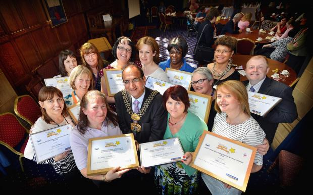 Bradford Telegraph and Argus: Councillor Khadim Hussain with winners in the Rhyme Challenge