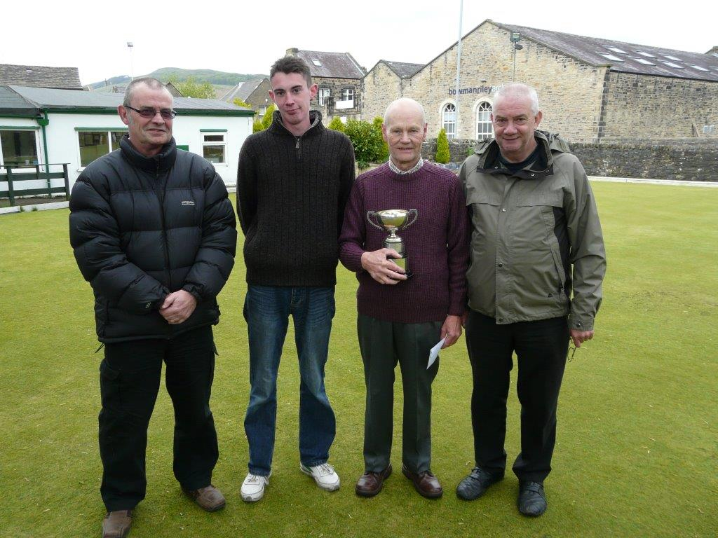 TROPHY TRIUMPH: Trevor Hargreaves with Worth Valley Bowling Association's Ogden Trophy, which he won after beating Anthony Emmott, second left, in the final at Craven BC