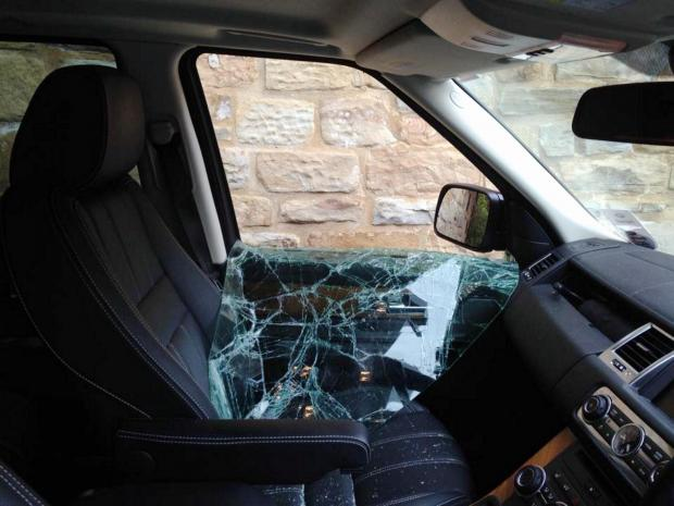 Shirley Uttley's Range Rover which had its window smashed and grill and headlights stolen