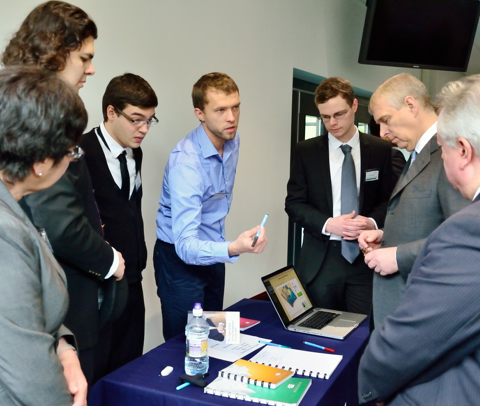 The Esquoia team showing their wipe-clean jotter to the Duke of York last week