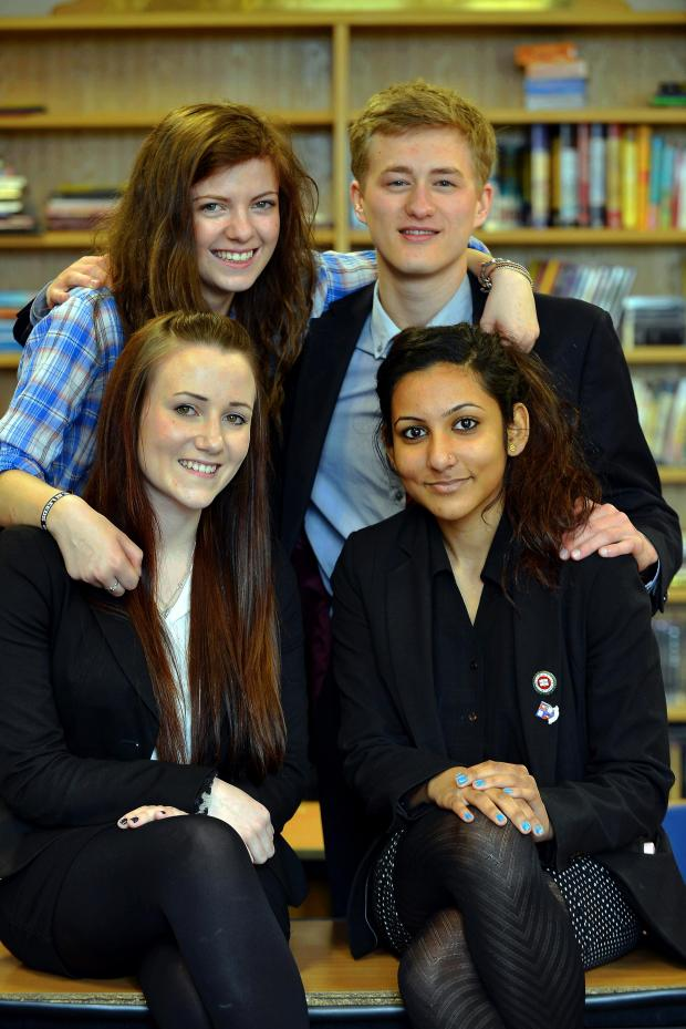 Bradford Telegraph and Argus: Members from the Barnardo's young carer's mentoring scheme at Bradford Grammar School, back (from left) Hollie Smallwood and Will Ashby and front (from left) Roma McNeil and Parvathi Kanakath
