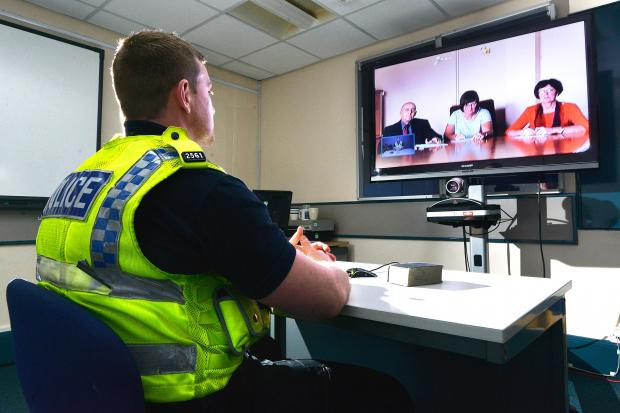 Police test the new video-link system which is predicted to save both time and money