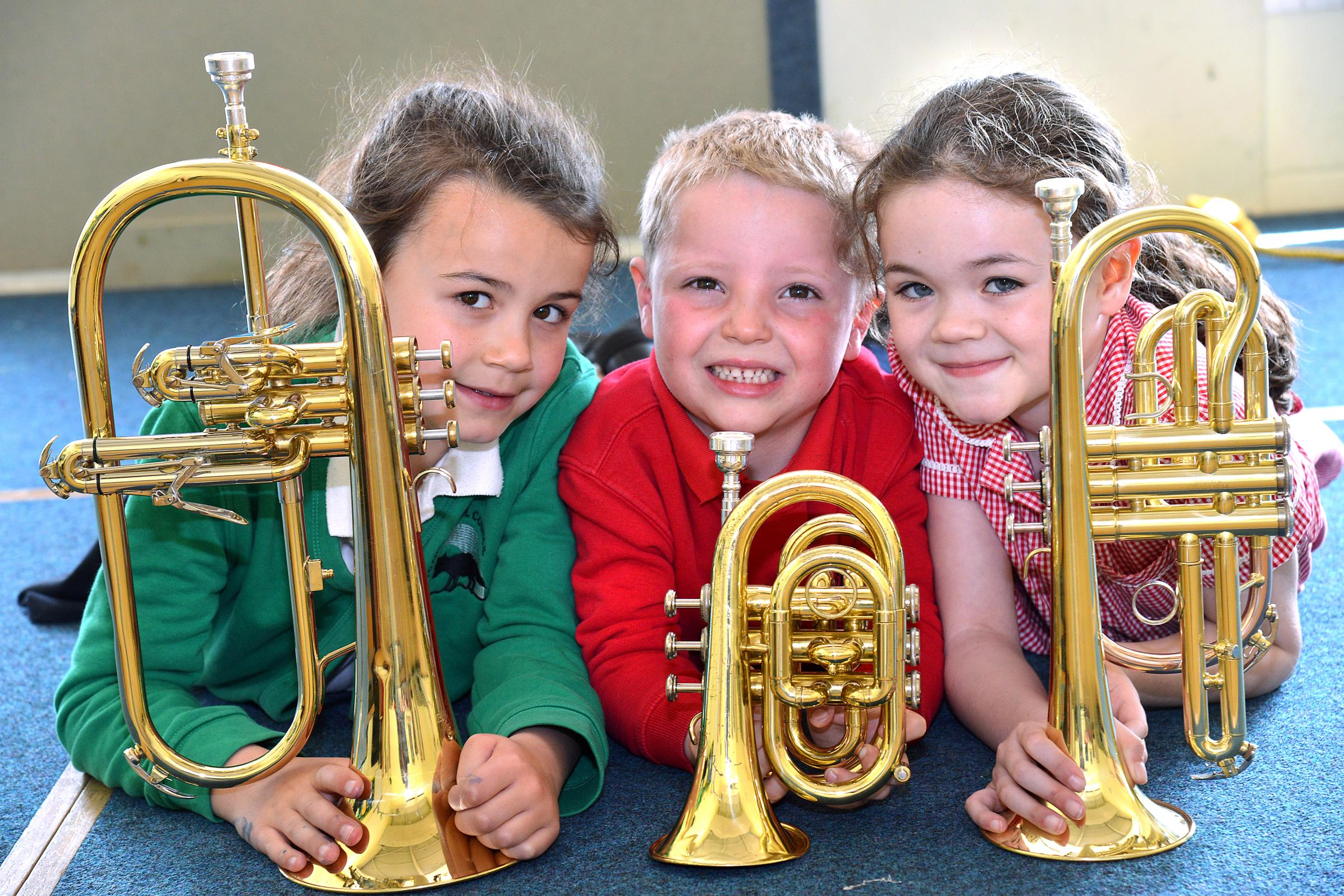 Foxhill Primary School pupils with their donated brass instruments after an appeal in the T&A